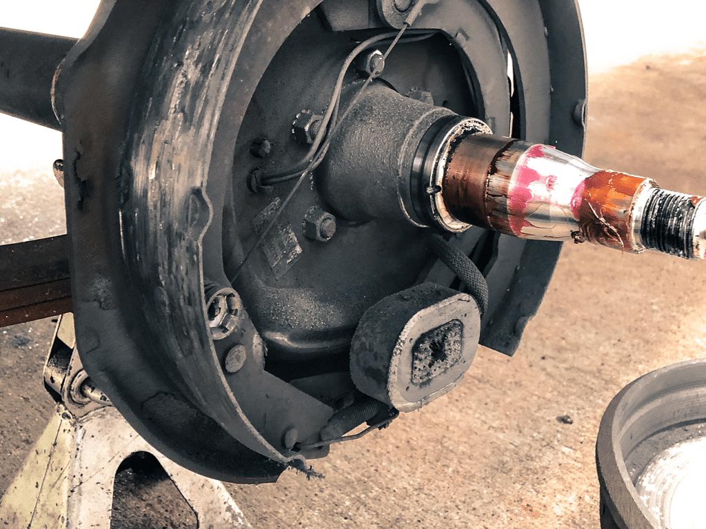 Close up image of brake pad being replaced